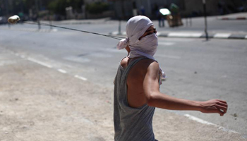 Palestinian protesters clash with Israeli soldiers in West Bank
