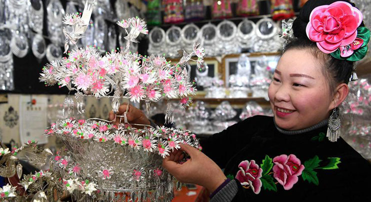 People prepare silver jewelry to greet Spring Festival in SW China