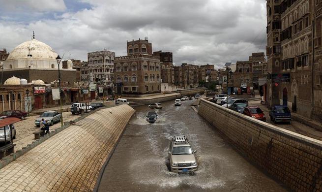 In pics: flooded street following heavy rain in Sanaa, Yemen