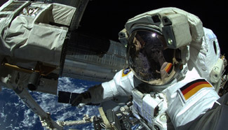 Astronauts take selfies outside of international space station