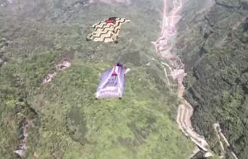 Faster than supercar! World-class wingsuiters fly in formation